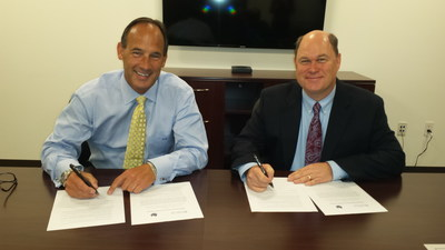 NACA Executive Director Kevin J. Allis and NASBP Chief Executive Officer Mark McCallum sign a Memorandum of Understanding to begin building a strategic partnership between the two organizations. (PRNewsFoto/NACA)