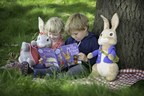Three year olds Harry Kassel and Jessica Nicholls enjoy a Peter Rabbit book under the 100 year old ash tree at Willows Activity Farm - soon to be the scene of the new adventure play area. (PRNewsFoto/Lappset)