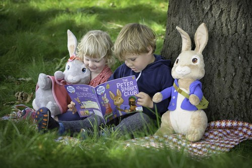 Three year olds Harry Kassel and Jessica Nicholls enjoy a Peter Rabbit book under the 100 year old ash tree at Willows Activity Farm - soon to be the scene of the new adventure play area. (PRNewsFoto/Lappset) (PRNewsFoto/Lappset)
