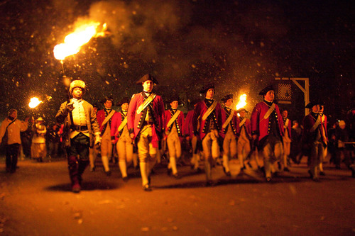 Marching down Duke of Gloucester Street during Grand Illumination on the first Sunday in December, the Fifes and Drums of Colonial Williamsburg signify to all the holiday season has arrived.  (PRNewsFoto/Greater Williamsburg, Colonial Williamsburg Foundation)