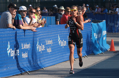 Courtesy of St. Anthony's Triathlon: Sarah Haskins makes her way to the finish line to win the professional women's division of the 2014 St. Anthony's Triathlon.