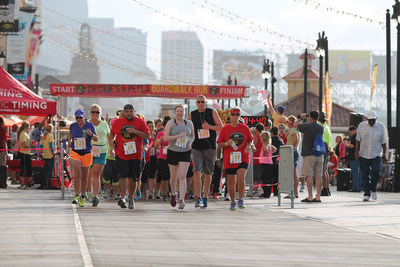 "1,100 enthusiastic runners break from the starting gate on the Atlantic City boardwalk for the first annual ""Boardwalk Run"" 5K hosted by Chickie's and Pete's, the Philadelphia-area sports bar and restaurant chain."