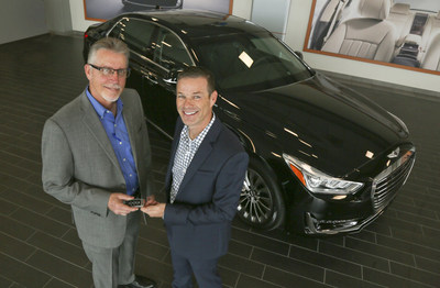 Russ Johnson, right, the first US buyer of the new 2017 Genesis G90, receives the key from Round Rock Genesis General Manager Mike Williams at the dealership in Round Rock, Texas.