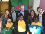 From left to right, Julie Kowalchick, PS 316 Elijah Stroud Elementary School Science Teacher, NY State Senator Jesse Hamilton, Larry White - VP Sales, Dole Packaged Foods, Principal Olaf Maluf, PS 316 and Leesa Carter, Executive Director, Captain Planet Foundation are joined by students from PS 316 Elijah Stroud Elementary School with salad greens from their new Learning Garden funded by Dole Packaged Foods and Key Food Stores.