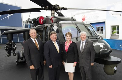 Viewing the armed helicopter with Lockheed Martin Chairman, President and Chief Executive Officer Marillyn Hewson are (from left) Sikorsky President Dan Schultz; Executive Vice President of Lockheed Martin Missiles and Fire Control Rick Edwards; and Executive Vice President of Mission Systems and Training Dale Bennett. Photo: Lockheed Martin