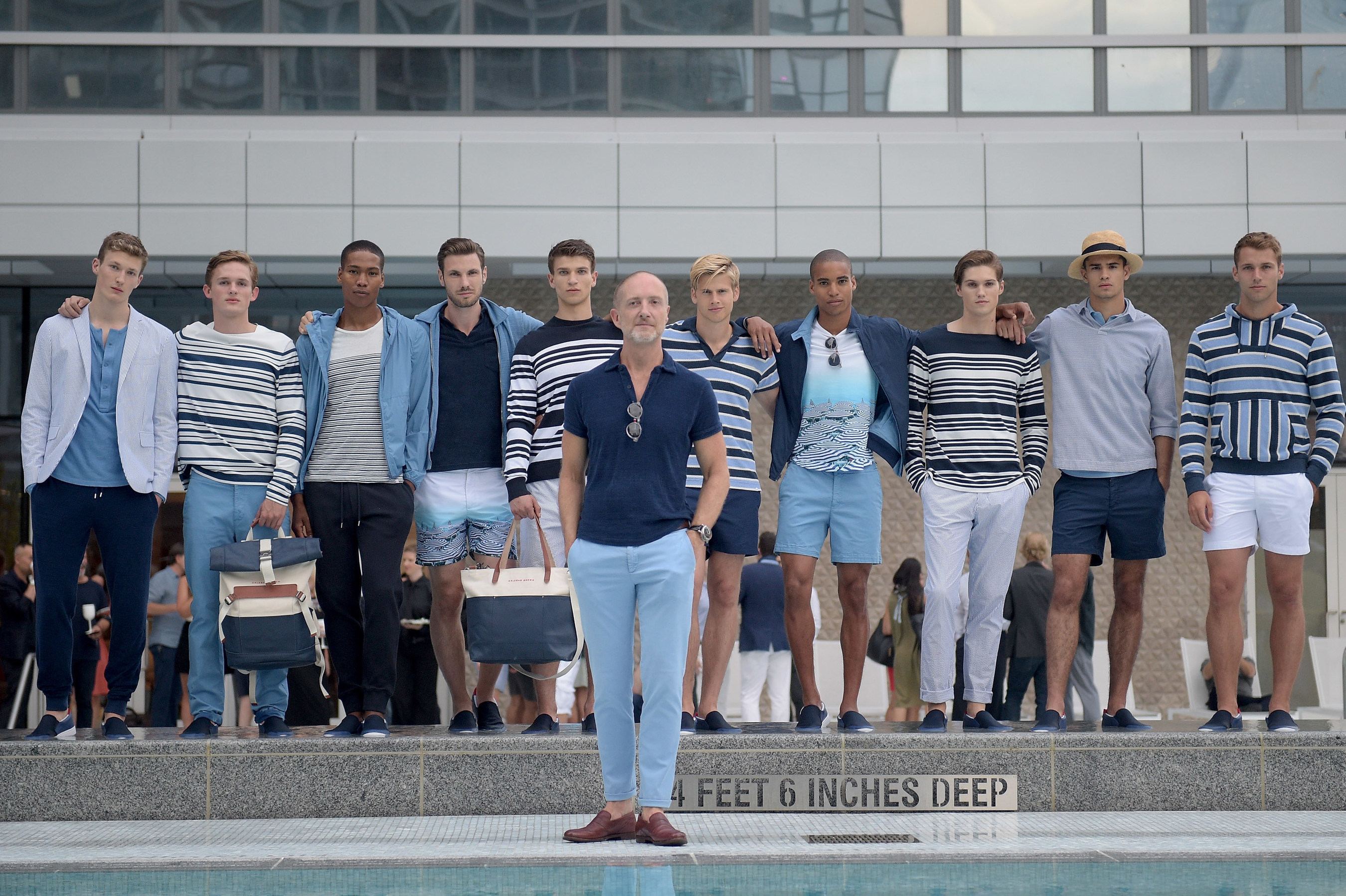 Founder and Creative Director Adam Brown poses with models at Orlebar Brown presents the Spring/Summer 2017 Collection in partnership with Bold New York and Lifetime Athletic At Sky.