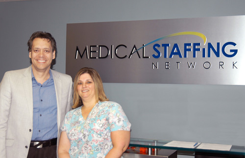 Medical Staffing Network Vice President of Marketing Christopher Gamble and October 2012 Nurse of the Month Contest Winner Amy Freeman, RN at MSN's Corporate Headquarters in Boca Raton, Florida.  (PRNewsFoto/Medical Staffing Network Healthcare, LLC)