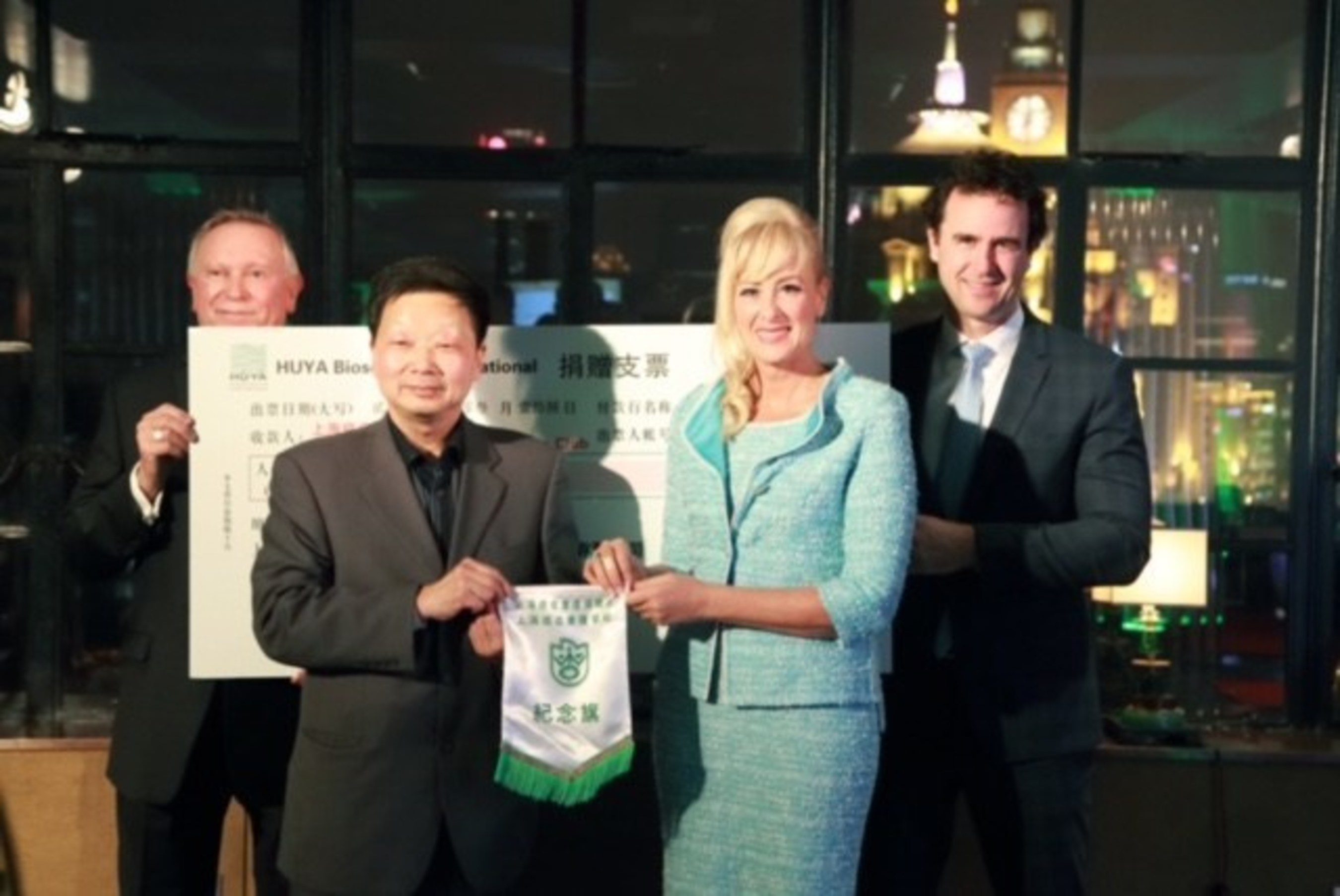 From left - Dr. Bob Goodenow, HUYA's Chief Business Officer; Mr. Fangda Hua, Secretary General of Shanghai Cancer Rehabilitation Club; Dr. Mireille Gillings, HUYA's President, CEO & Executive Chair; Mr. Clement Gingras, HUYA's CTO & COO Asia.