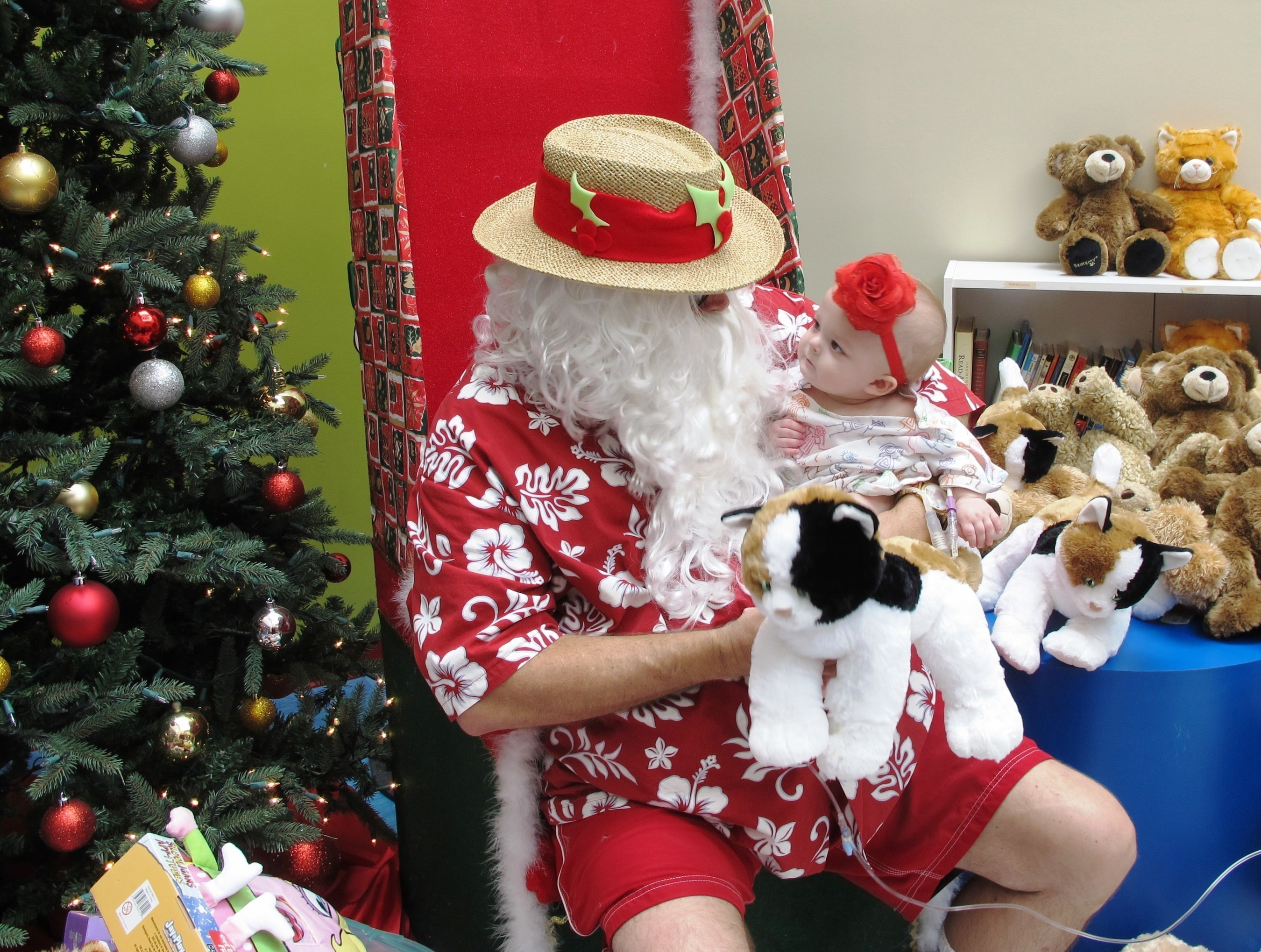 Donations made during St. Joseph's Children's Hospital's Christmas in July drive will help provide toys, activities like art and music therapy and other distraction experiences for patients like Ella, who has spent months of her young life in the hospital.