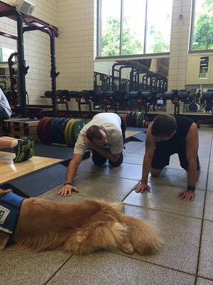 Warriors and a service dog participate in specialized training during a workout at the University of Minnesota. The event sponsored by Wounded Warrior Project.