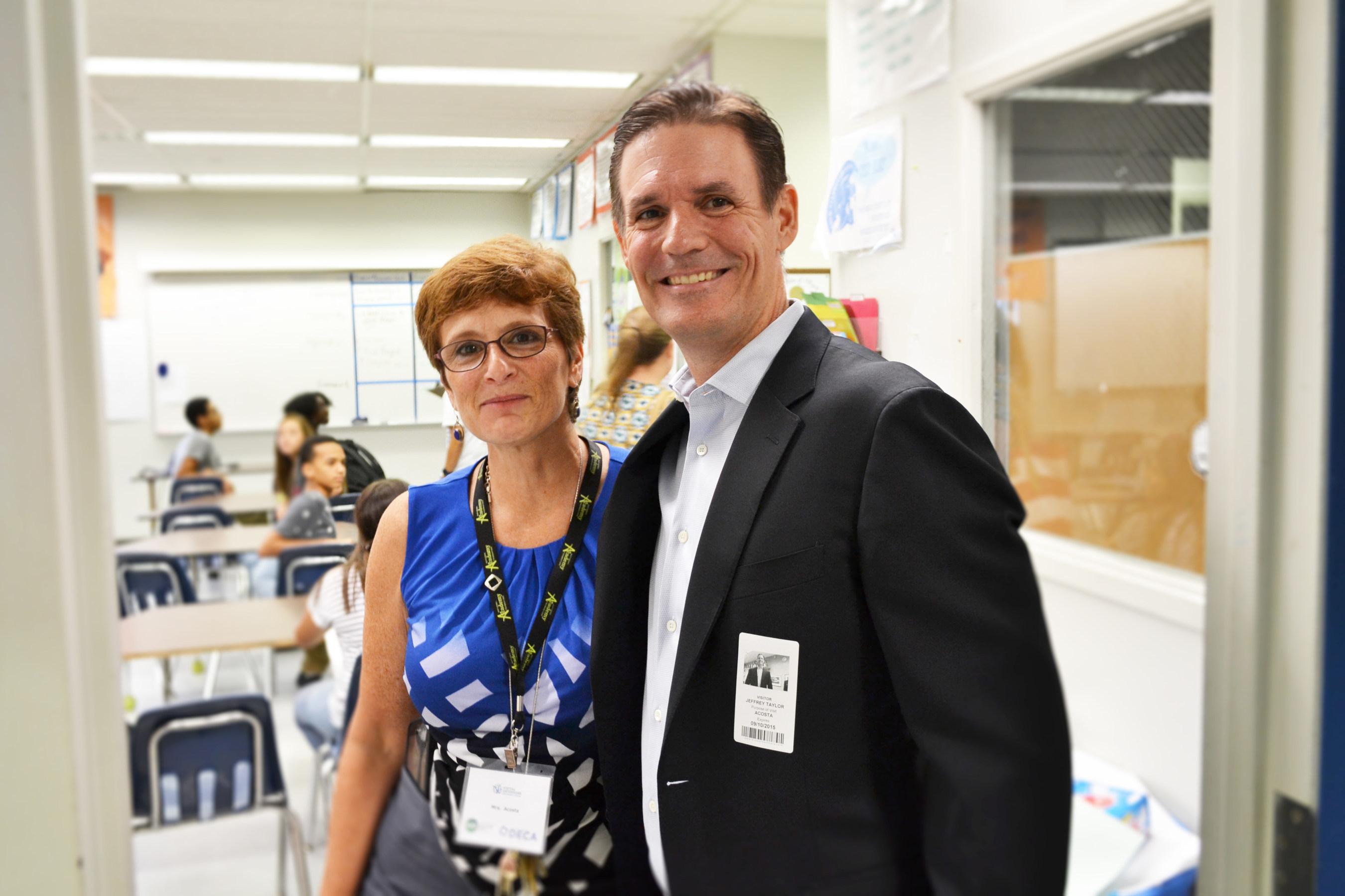 Digital Risk Co-founder & Managing Partner Jeff Taylor and J.P. Taravella High School Teacher Laurie Acosta, on-site coordinator of the school's VEI program.