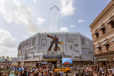 Universal Orlando today marked the grand opening of TRANSFORMERS: The Ride - 3D, one of this summer's most highly anticipated theme park entertainment experiences. The opening event - which took place in front of thousands of theme park guests - featured huge pyrotechnics, a high-speed jet acrobatic team and more - all within view of the attraction's three-story-tall, six-ton, Optimus Prime figure.  (c) 2013 Universal Orlando Resort. All rights reserved.  (PRNewsFoto/Universal Orlando Resort)