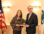 Passing of the Gavel: Alison Lewis, global CMO, Johnson & Johnson Consumer Companies and first chairwoman to serve on National 4-H Council's Board of Trustees, accepts the gavel from outgoing Board of Trustees Chair James Borel, EVP, DuPont Company.  (PRNewsFoto/National 4-H Council)