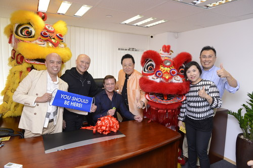 WorldVentures Vice President, International Kyle Lowe (seated), Independent Representatives and members celebrate the opening of the company's Field Training Center in Hong Kong. (PRNewsFoto/WorldVentures)
