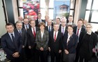 """Thomas Geisel, Lord Mayor of Dusseldorf (in the middle of first row), welcomed his colleagues from the participant cities and regions to the """"Tour-Summit"""" in the Dusseldorf Castle Tower. (PRNewsFoto/City of Duesseldorf)"""