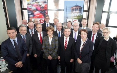 "Thomas Geisel, Lord Mayor of Dusseldorf (in the middle of first row), welcomed his colleagues from the participant cities and regions to the ""Tour-Summit"" in the Dusseldorf Castle Tower. (PRNewsFoto/City of Duesseldorf)"