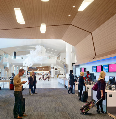 """VIRGIN AMERICA LAUNCHES """"DEALS ON THE FLY"""" WITH LOOPT THROUGHOUT SFO'S TERMINAL 2.  (PRNewsFoto/Virgin America, Bruce Damonte)"""