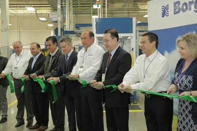 BorgWarner opened an expanded facility in Ramos-Arizpe, Mexico, to meet accelerating demand for advanced exhaust gas recirculation and ignition technologies. Government and company officials attending the event included (left to right): Melchor Sanchez, Local Congressman; Marcos Duran Flores, Federal Delegate for the Secretary of Economy; Jose Antonio Gutierrez Jardon, Secretary for Economic Development, Tourism and Competitiveness of Coahuila State; Christopher Lanker, General Manager, BorgWarner Emissions Systems North America; Ruben Moreira Valdez, Coahuila State Governor; Alberto Sanchez, Plant Manager, BorgWarner Emissions Systems Ramos; Ricardo Aguirre, Mayor of Ramos-Arizpe; and Erika Nielsen, Director, Global Government Affairs, BorgWarner.