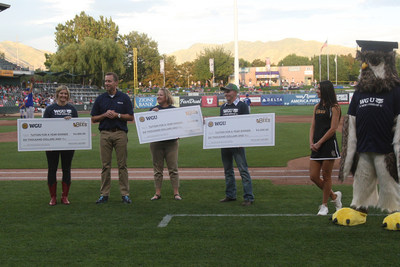 WGU President Scott Pulsipher presents scholarships to three local students at the Bees' last home stand of the season.
