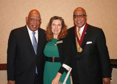 (L-R) Orlando Taylor, Fielding Graduate University's vice president of strategic initiatives and research, and Fielding President Katrina Rogers present Walter Bumphus with the inaugural Marie Fielder Medal at the Jan. 15 Santa Barbara launch of the Marie Fielder Center for Democracy, Leadership, and Education.