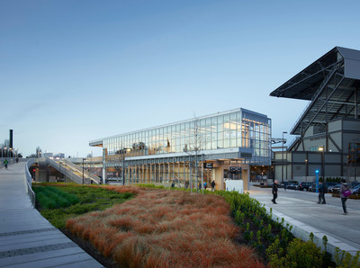 University of Washington Station. The light-filled entrance structure frames views of the surrounding context, including Lake Washington and the Cascade Mountains. Photo by Kevin Scott.