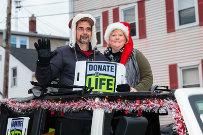 Jim, who got a donor heart June 2013, and Julie LaFontaine urge organ donation as 2014 Gloucester, Massachusetts Santa Parade grand marshals.