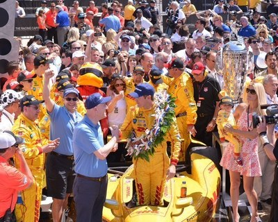 Standing beside the Borg-Warner Trophy(TM) in Victory Lane, BorgWarner President and Chief Executive Officer James Verrier congratulated Ryan Hunter-Reay on his victory at the Indianapolis 500. Photo by Rob Banayote (PRNewsFoto/BorgWarner Inc.)
