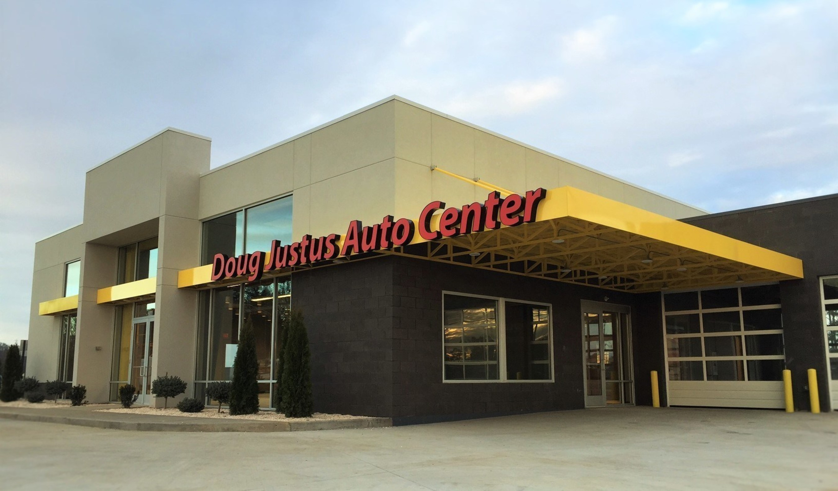 The all-new 4,680 sq. ft. Doug Justus Auto Center differentiates itself from traditional pre-owned automotive dealers by providing a contemporary interior and exterior design similar to the approach that many new, modern auto dealerships have embraced.