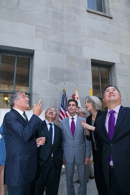San Francisco Mayor Ed Lee along with State Senator Mark Leno and Assemblymember Phil Ting look on as California Historical Society executives highlight architectural aspects of the treasured Old U.S. Mint building.  L to R: Mike Sangiacomo, CHS Board of Trustees president; Mayor Lee; Senator Leno; Anthea Hartig, executive director, CHS; Assemblymember Ting.  (Photo credit: Amy Sullivan)