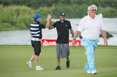 Basketball Hall of Famer Allen Iverson high-fives Liverpool football legend Robbie Fowler during their round with golfing champion John Daly at 2016 Mission Hills World Celebrity Pro-Am in China.