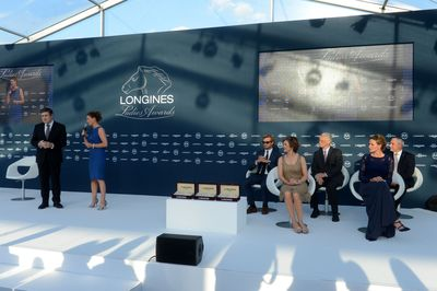 The stage of the Longines Ladies Awards ceremony. Juan-Carlos Capelli, Vice President of Longines and Head of International Marketing, Liz Price, presenter, Simon Baker, Longines Ambassador of Elegance and President of the jury of the Longines Ladies Awards, Nathalie Bélinguier, President of the International Federation of Gentlemen and Lady Riders, Louis Romanet, Chairman of International Federation of Horseracing Authorities, Francesca Cumani, presenter of equestrian sports at CNN and Ingmar de Vos, Secretary General of the Fédération Equestre Internationale.