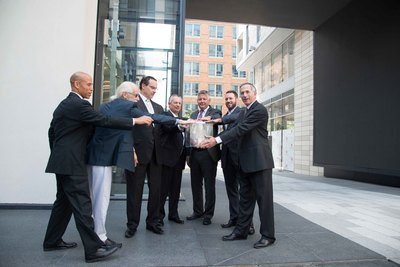 "The Gateway at CityCenter is unveiled for the first time in an official ""button pushing"" ceremony - in attendance from left to right: Harry Wingo, President & CEO, D.C. Chamber of Commerce; David Niles, Niles Creative Group; The Honorable Vincent C. Gray, Mayor, District of Columbia; William B. Alsup, III, Senior Managing Director, Hines; Jeffrey Miller, Interim Deputy Mayor for Planning and Economic Development, District of Columbia; Joseph P. Lapan, Esq., LEED AP, Project Manager, Office of the Deputy Mayor for Planning & Economic Development, District of Columbia; Howard J. Riker, Managing Director, Hines (PRNewsFoto/CityCenterDC)"