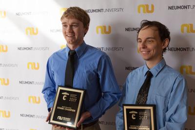 Tyler Berry and Kyle Kacprzynski celebrate as winners of Neumont university's 2017 Capstone Project Invitational.  (PRNewsFoto/Neumont University)