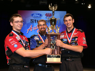 Logan Boyle and Cody Collins from Vale High School in Oregon celebrate with their instructor, Drew Barnes, after winning the National Championship at the 64th Annual Ford/AAA Student Auto Skills Competition on June 11, 2013 at Ford World Headquarters in Dearborn, Mich.  (PRNewsFoto/AAA)