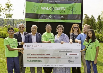 BAPS Charities donated $100,000 to The Nature Conservancy which will help plant a billion trees by 2025 and 70,000 trees by end of 2016.  From Left to Right Parth Patel, BAPS Charities Board Members - Praful Raja, Rati Patel, Yogendra Parmar, The Nature Conservancy representatives - Maria Fisher, Erin Daly, John Stapleton,   and Moksha Patel. Over 17,000 BAPS Charities volunteers took park in BAPS Charities Walkathons organized in  53 cities across USA to take action for reversing the impact of global warming.