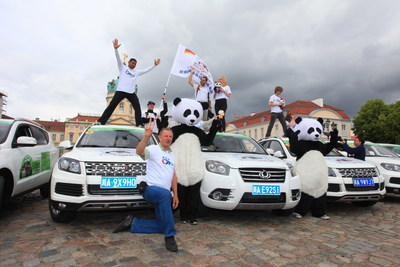 """The European fans of giant panda and the SUVs """"made in Chengdu"""" made their stage poses in Charlottenburg Palace in Berlin, Germany."""