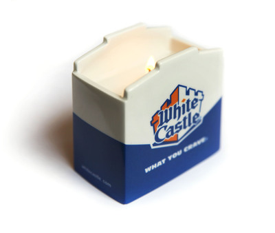 Anyone who craves the unforgettable flavor of White Castle's Original Slider(R) remembers the mouth-watering aroma. Now, White Castle is offering its unique Original Slider-scented candle on houseofcrave.com with net proceeds benefiting the nation's largest autism research and advocacy organization, Autism Speaks. Designed by Laura Slatkin, the award-winning founder of Nest Fragrances, this limited-edition candle comes in a ceramic replica of the signature White Castle Slider box. In support of National Autism Awareness Month, White Castle offers these limited-edition candles for $15 each. Since 2010, White Castle has sold more than 10,000 candles, raising more than $100,000.  (PRNewsFoto/White Castle)