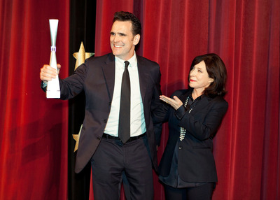 Actor Matt Dillon accepts the Outstanding Achievement in Cinema Award from SCAD President and Co-founder Paula Wallace at the 15th annual Savannah Film Festival.
