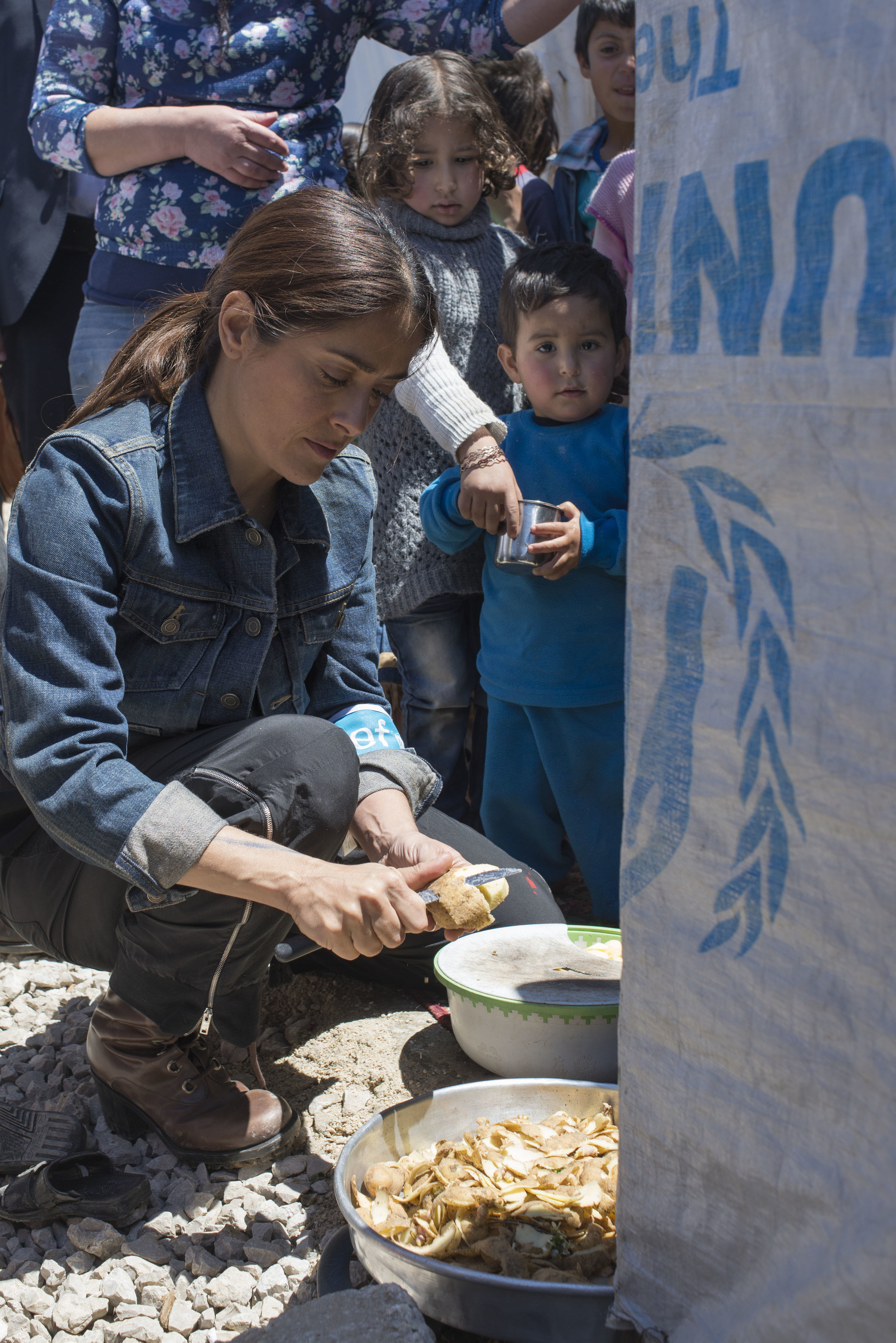 UNICEF supporter and CHIME FOR CHANGE campaign Co-Founder Salma Hayek helps prepare food for Syrian refugees in Lebanon. On April 25, Hayek visited the region with UNICEF to draw attention to the urgent humanitarian needs of children and families whose lives have been upended by the conflict in Syria. Hayek also helped launch Gucci's CHIME for the Children of Syria, a fundraising appeal to support children and families affected by the crisis.