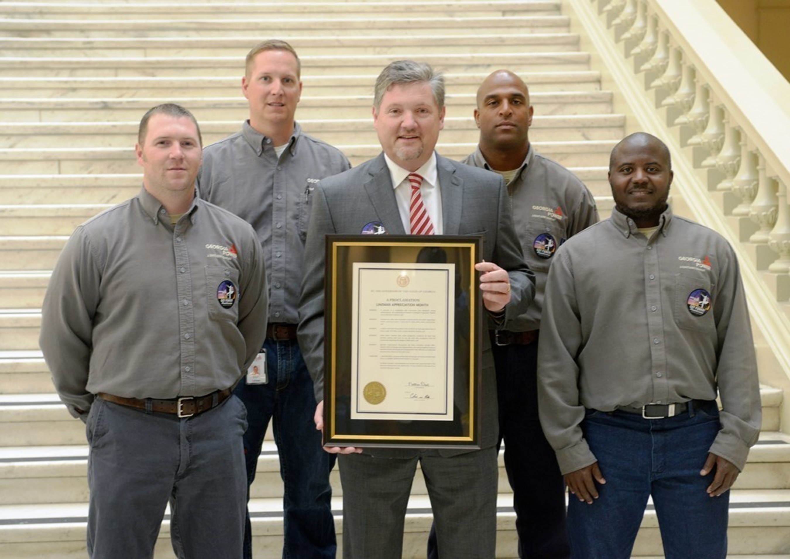 Danny Lindsey, Georgia Power Vice President of Transmission, and Georgia Power linemen during a special event at the Georgia Capitol on Tuesday, April 19.