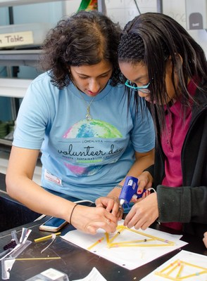 L'Oreal USA's 2013 For Women in Science fellow, Anisa Ismail, helps a student build a spaghetti bridge.