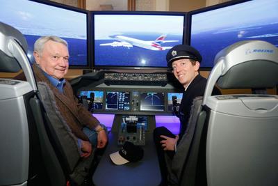 Austin Mayor Lee Leffingwell and inaugural British Airways Captain Dave Willsher  flying the 787 Dreamliner Simulator and welcoming British Airways to Austin, Texas.  (PRNewsFoto/British Airways)