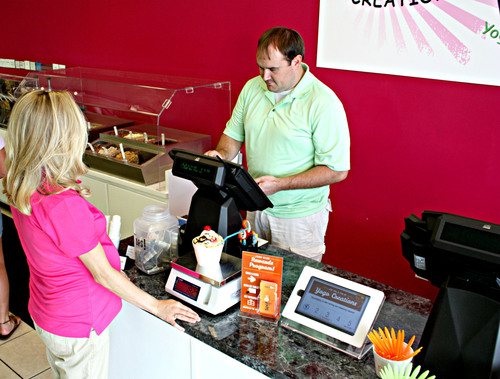 SpotOn helps build customer loyalty with its tablet-based program at YoGo Creations, a frozen yogurt shop in Greenville, South Carolina.  (PRNewsFoto/SpotOn, Sarah Holder Photography)