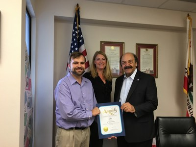 Assemblymember Katcho Achadjian presenting certificate for Brilliance in Technology to Softec with Joshua Erdman, President of the Board and Robin Mitchell Hee, Board Member