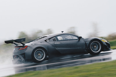 The Acura NSX GT3 features custom carbon fiber bodywork and aero components including a large deck wing spoiler, underbody diffuser and enlarged hood vents for efficient engine cooling.
