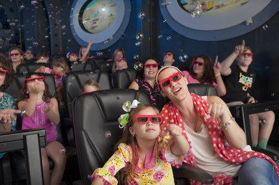 Children and parents wearing 3D glasses enjoy a wild and silly submarine voyage as they're immersed in special effects during the SpongeBob SubPants Adventure opening Memorial Day Weekend at Moody Gardens in Galveston, Texas.