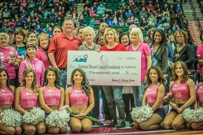 James and Sherry Green, owners of A#1 Air, award a $50,000 check to National Breast Cancer Foundation at the February 6th Texas Legends basketball game, Dr. Pepper Center in Frisco, Texas