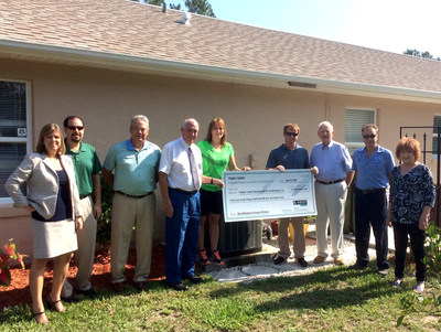 Pictured are (left to right): Rebecca DeLorenzo, President & CEO, Flagler Chamber of Commerce; Jason DeLorenzo, Government Affairs Director, Flagler Home Builders Association; Mark Pierson, Outreach Manager, Florida PACE Funding Agency; Charles Ericksen, Vice Chairman, District 1, Flagler County Board of County Commissioners; Jill Trecki, Homeowner; Dan Gouldner, Office Manager, Flagler County Heating & Air Conditioning; Sinclair Stickle, Owner, Flagler County Heating & Air Conditioning; Norton Teixeira...