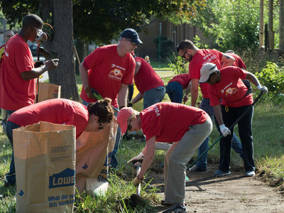 DTE Energy employees kicked-off their Month of Caring activities cleaning up the grounds of a local church.