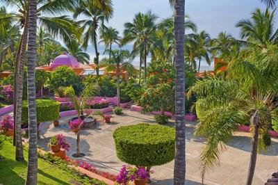 The fountains and lush gardens of Plaza De Los Delfines at Las Alamandas Resort.